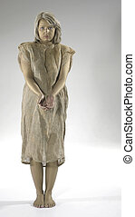 begging poor girl dressed in a gunnysack, Studio shot in...