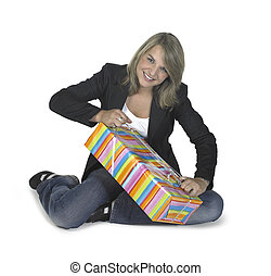 sitting girl unwrapping a present - cute blond girl sitting...