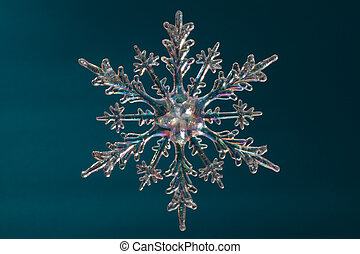 Snowflake shape, photo on the blue background