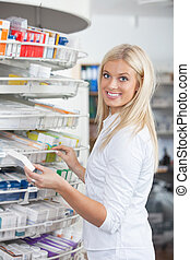 Woman Standing in Pharmacy Drugstore - Portrait of woman...