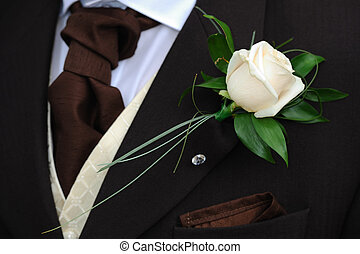 Grooms flower and cravat. - Closeup of grooms rose and...