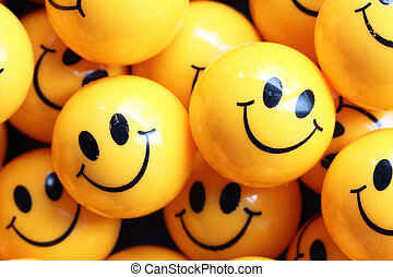 community support concept - heap of yellow balls with smiley...