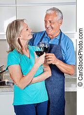 Senior Couple Toasting Wine - Happy senior couple toasting...