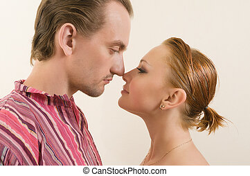 Touching noses - Young couple touching noses - eskimo kiss