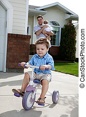 Toddler Riding Bicycle - Toddler boy learning to ride...