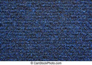 A blue carpet texture, close-up