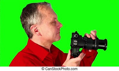 Close-up photographer on a green sc - Photographer with...