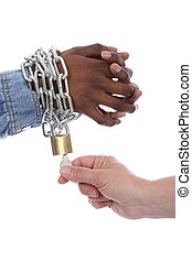 African Freedom Concept - Hand of caucasian woman freeing...