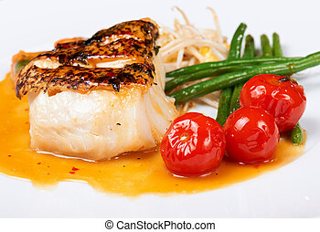 grilled fish with runner beans and cherry tomatoes on white...