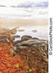 Fog coast landscape - Beautiful autumn scene with fog and...