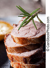slices of roasted pork fillet with rosemary