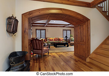 Entry into luxury living room with arch