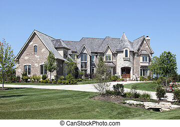 Luxury home with stone turret - Large luxury brick home with...