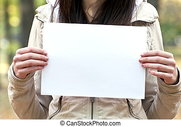 Woman holding empty paper in hands