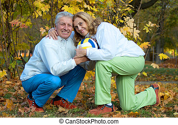 olds with ball - portrait of a lovely old couple with ball