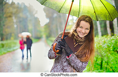 Girl under Rain - laughing girl and walking couple under...
