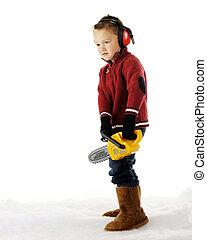 Ready for Tree Cutting - A preschool boy in winter wear He...
