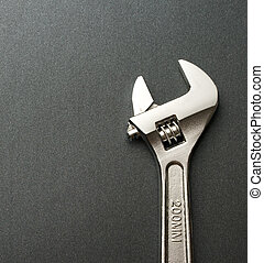 Spanner on a grey background