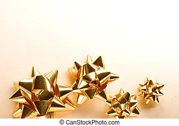 A string of golden christmas bows