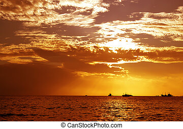 sun hiding - Golden sunset and reflection with ships...