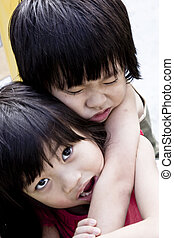Caring sibling - Caring Asian Sister carrying injured little...