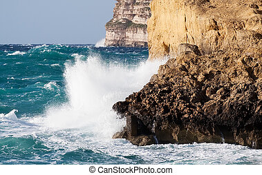 Sea wave breaking against cliff - Storm Sea wave breaking...