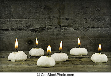 candle light - six candle on wooden background