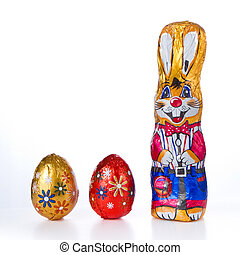Easter bunny with eggs - wrapped chocolate Easter bunny with...