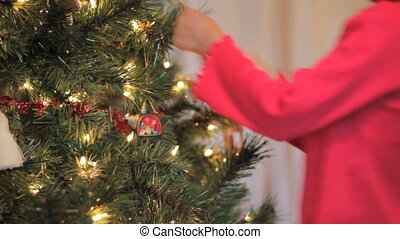 Girl Hanging A Christmas Ornament - A cute little 5 year old...