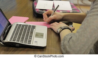 Girl Writing Thank You Notes - A female young adult...