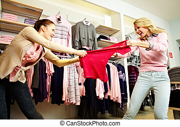 Shopping violence - Image of two greedy girls fighting for...