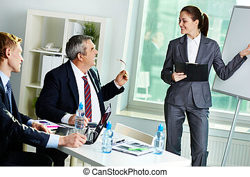 Presentation - Portrait of successful female presenting her...