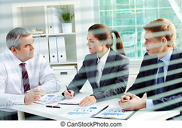Planning work - Portrait of busy people discussing new...