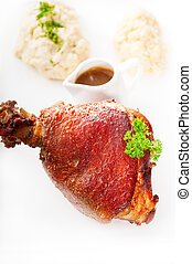 original German BBQ pork knuckle served with mashed potatoes...