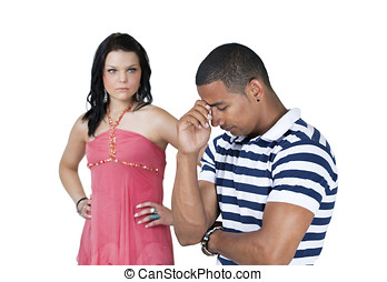 Unhappy couple with focus on man - An unhappy couple with...