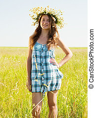 girl in flower chaplet - long-haired teen girl in flower...