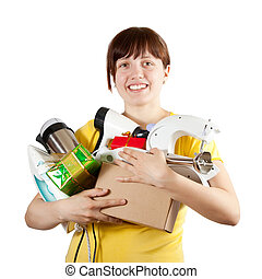 woman with household appliances - young woman in yellow with...
