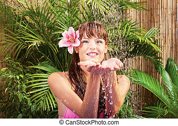 Water dropping on woman's hands
