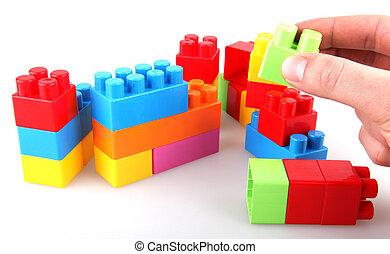 Plastic toy blocks on white background