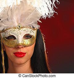 Young woman wearing a venetian mask