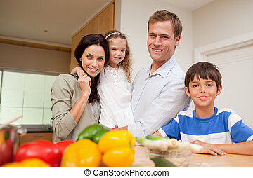Family standing in the kitchen