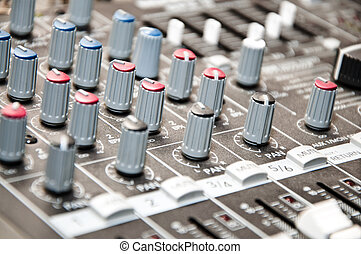 sound mixer - close up shot of sound mixer in studio