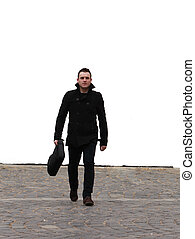 Businessman in the city - Young businessman walking through...