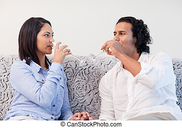 Couple drinking sparkling wine in the living room
