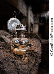 Old kerosene lamp in an abandoned, gloomy, creepy building...