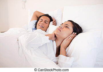 Woman cant sleep next to her snoring boyfriend - Young woman...