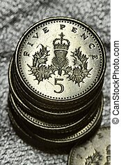 A pile of five pence coins