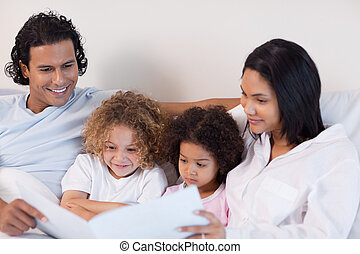 Happy family enjoys reading a story together