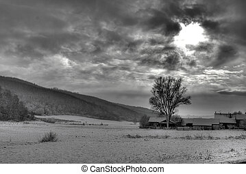 Dramatic sky, sun rays through clouds - BW photo of dramatic...