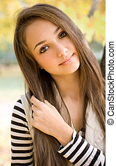 Beautiful young model in the park. - Beautiful slender young...